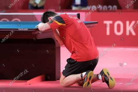 Dimitrij Ovtcharov defeats Lin Yun Ju and drops to his knees during the Men's Table Tennis Singles Bronze Medal Match between Lin Yun Ju of Chinese Taipei and Dimitrij Ovtcharov of Germany on Day 7 of the Tokyo 2020 Olympic Games