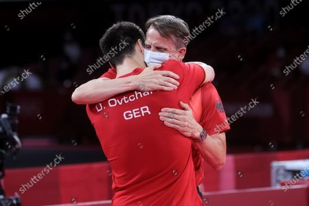 Dimitrij Ovtcharov defeats Lin Yun Ju and embraces his team during the Men's Table Tennis Singles Bronze Medal Match between Lin Yun Ju of Chinese Taipei and Dimitrij Ovtcharov of Germany on Day 7 of the Tokyo 2020 Olympic Games