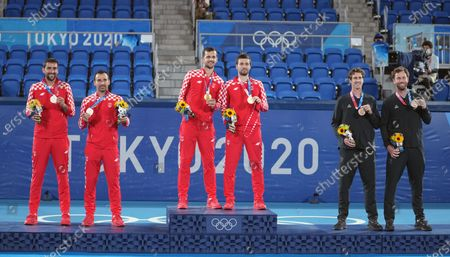 Stock Photo of (210730) - TOKYO, July 30, 2021 (Xinhua) - Gold Medalist Nikola Mektic/Mate Pavic of Croatia (C), Silver Medalist Marin Cilic/Ivan Dodig of Croatia (L) and Bronze medalist Marcus Daniell/Micael Venus of New Zealand pose at the awarding ceremony of men's doubles of tennis at the Tokyo 2020 Olympic in Games Tokyo, Japan, July 30, 2021.