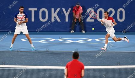 Editorial image of Japan Tokyo Oly Tennis Men's Doubles - 30 Jul 2021