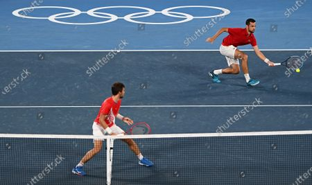 Stock Picture of (210730) - TOKYO, July 30, 2021 (Xinhua) - Nikola Mektic (L) /Mate Pavic of Croatia compete during the men's doubles final tennis match between Nikola Mektic/Mate Pavic of Croatia and Marin Cilic/Ivan Dodig of Croatia at the Tokyo 2020 Olympic Games in Tokyo, Japan, July 30, 2021.