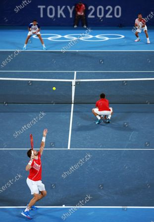 (210730) - TOKYO, July 30, 2021 (Xinhua) - Nikola Mektic (L) /Mate Pavic of Croatia compete during the men's doubles final tennis match between Nikola Mektic/Mate Pavic of Croatia and Marin Cilic/Ivan Dodig of Croatia at the Tokyo 2020 Olympic Games in Tokyo, Japan, July 30, 2021.