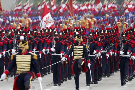 Stock Photo of Members of the Mariano Santos Mateus Company of the National Police participate in a military parade for the National Holidays, at the Army Headquarters, in Lima, Peru, 30 July 2021. In this parade, the Armed Forces and the National Police of Peru recognized President Pedro Castillo as their supreme leader.