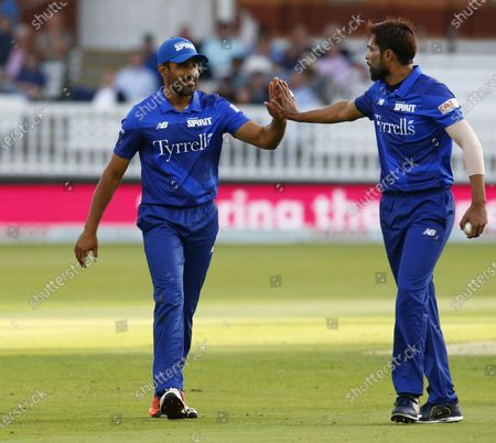 Stock Photo of L-R Ravi Bopara of London Spirit and Mohammad Amir of London Spirit during The Hundred between London Spirit Men and Trent Rockets Men at Lord's Stadium , London, UK on 29th July 2021