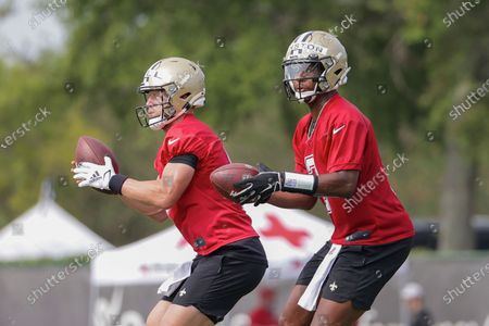 New Orleans Saints quarterback Jameis Winston (2) and quarterback Taysom Hill (7) take snaps during NFL football training camp in Metairie