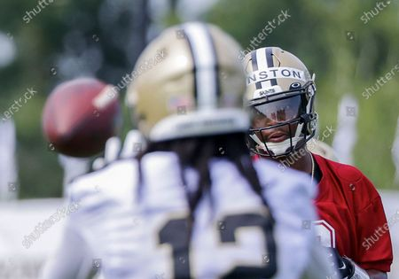 New Orleans Saints quarterback Jameis Winston (2) throws to wide receiver Marquez Callaway (12) during NFL football training camp in Metairie