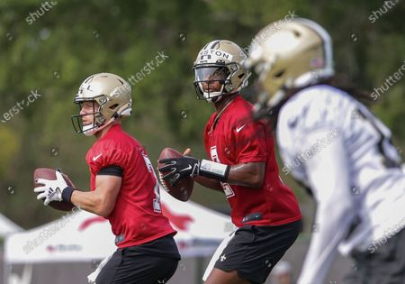 New Orleans Saints quarterback Jameis Winston (2) and quarterback Taysom Hill (7) drop back to pass during NFL football training camp in Metairie