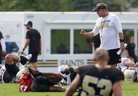 New Orleans Saints head coach Sean Payton talks with quarterback Jameis Winston (2) while stretching during NFL football training camp in Metairie