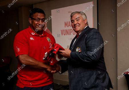Mako Vunipola receives their jersey from Jason Leonard