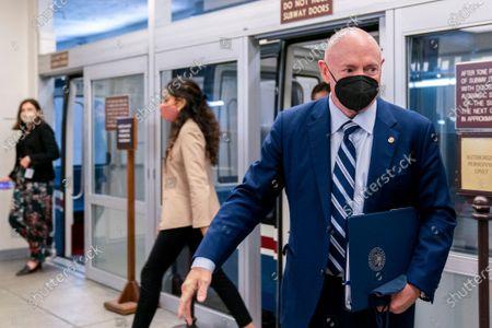 Sen. Mark Kelly, D-Ariz., waits for a Senate subway train on Capitol Hill in Washington