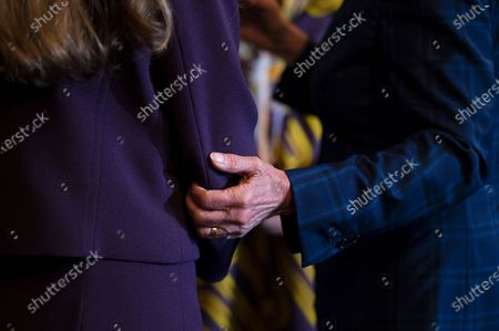 House Speaker Nancy Pelosi (D-CA) grasps the arm of U.S. Representative Jennifer Wexton (D-VA) while speaking with lawmakers after a signing ceremony for H.R. 3237 - the Emergency Security Supplemental to Respond to January 6th Appropriations Act, in Washington, DC, on July 30, 2021