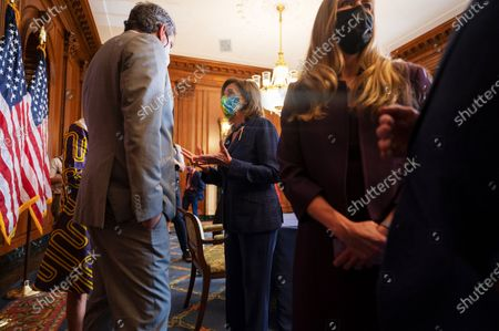 House Speaker Nancy Pelosi (D-CA) speaks with lawmakers after a signing ceremony for H.R. 3237 - the Emergency Security Supplemental to Respond to January 6th Appropriations Act, in Washington, DC, on July 30, 2021