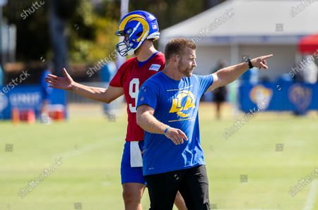 Rams head coach Sean McVay and the Rams new starting quarterback Matthew Stafford (9) on the first day of training camp at UC Irvine on July 28, 2021 in Irvine, California.(Gina Ferazzi / Los Angeles Times)