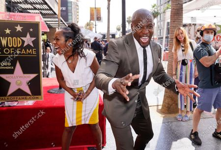Stock Image of Actor and television personality Terry Crews, right, poses for photographers alongside guest speaker Tichina Arnold before a ceremony to award him a star on the Hollywood Walk of Fame, in Los Angeles