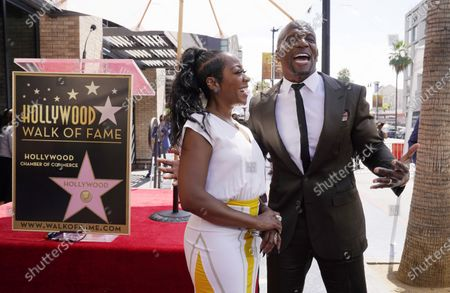 Actor and television personality Terry Crews, right, poses alongside guest speaker and actress Tichina Arnold before a ceremony to award him a star on the Hollywood Walk of Fame, in Los Angeles