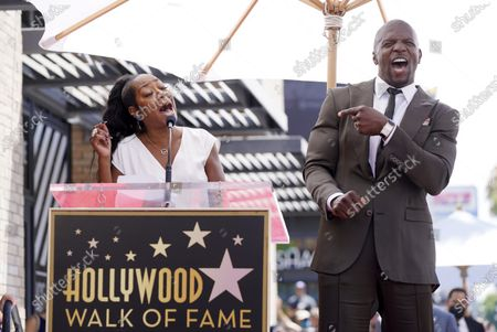 """Actor and television personality Terry Crews, right, listens as guest speaker Tichina Arnold sings """"Happy Birthday"""" to him during a ceremony to award him a star on the Hollywood Walk of Fame, in Los Angeles. Crews turns 53 today"""