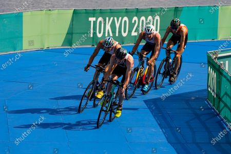 Jonathan Brownlee of Britain leads the pack on the bike leg during the mixed relay triathlon at the 2020 Summer Olympics, in Tokyo, Japan