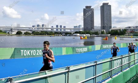 Jonathan Brownlee of Great Britain competes in the Triathlon Mixed relay at the Tokyo 2020 Olympic Games at the Odaiba Marine Park in Tokyo, Japan, 31 July 2021.
