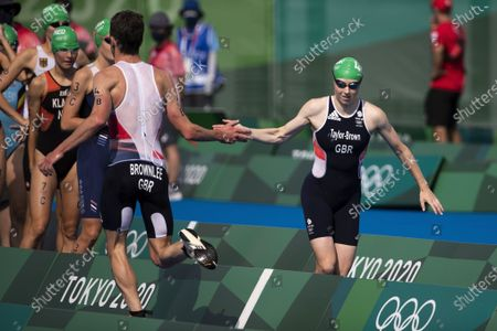 Britain's Jonathan Brownlee hands over to teammate Georgia Taylor-Brown in the Triathlon Mixed Relay competition at the 2020 Tokyo Summer Olympics in Tokyo, Japan, 31 July 2021.