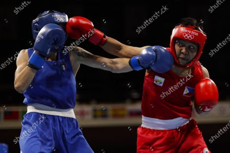 Philippines' Nesthy Petecio, right, punches Italy's Irma Testa during a women's featherweight 57-kg boxing semifinal match at the 2020 Summer Olympics, in Tokyo, Japan
