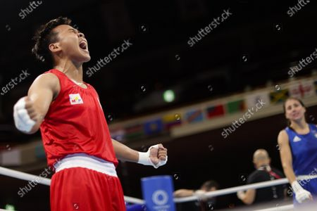 Philippines' Nesthy Petecio reacts after winning a women's featherweight 57-kg boxing semifinal match against Italy's Irma Testa at the 2020 Summer Olympics, in Tokyo, Japan
