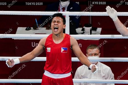 Philippines' Nesthy Petecio celebrates after winning her women's featherweight 57-kg semifinal boxing match against Italy's Irma Testa at the 2020 Summer Olympics, in Tokyo, Japan