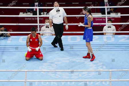 Philippines' Nesthy Petecio reacts after winning her women's featherweight 57-kg semifinal boxing match against Italy's Irma Testa, right, at the 2020 Summer Olympics, in Tokyo, Japan