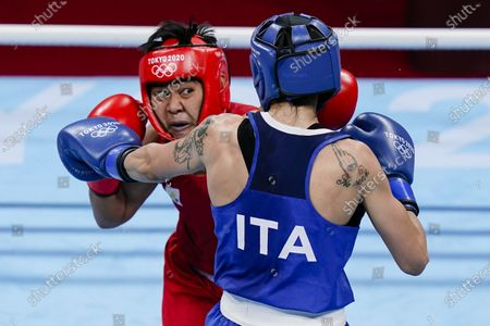 Philippines' Nesthy Petecio, left, punches Italy's Irma Testa during their women's semifinal featherweight 57-kg boxing match at the 2020 Summer Olympics, in Tokyo, Japan