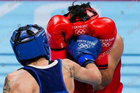 Italy's Irma Testa, left, punches Philippines' Nesthy Petecio during their women's semifinal featherweight 57-kg boxing match at the 2020 Summer Olympics, in Tokyo, Japan
