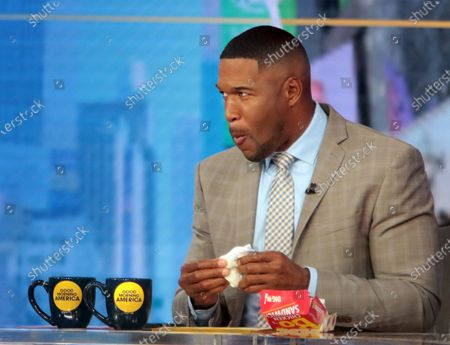 Michael Strahan on Good Morning America seen having a Bojangles chicken sandwich