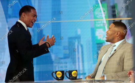 T.J. Holmes, Michael Strahan, on the set of Good Morning America