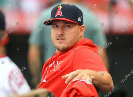Los Angeles Angels' Mike Trout sits in the dugout during a baseball game against the Oakland Athletics, in Anaheim, Calif