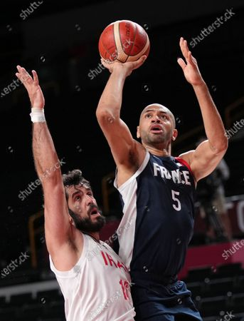 Nicolas Batum (R) of France in action against Mohammadsamad Nik Khahbahrami of Iran  during the Men's Basketball Preliminary Round Group A between Iran and France of the Tokyo 2020 Olympic Games at Saitama Super Arena in Saitama, Japan, 31 July 2021.
