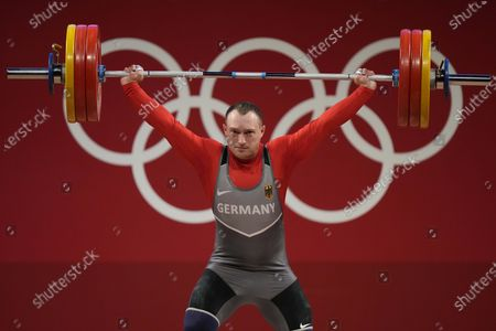 Nico Mueller of Germany competes in the men's 81kg weightlifting event, at the 2020 Summer Olympics, in Tokyo, Japan