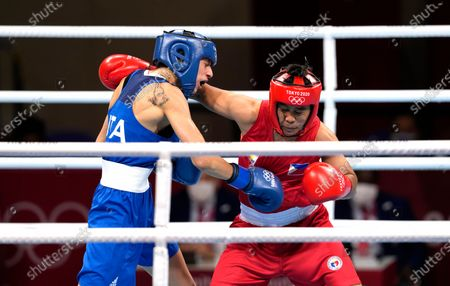 Philippines' Nesthy Petecio, right, punches Italy's Irma Testa during their women's semifinal featherweight 57-kg boxing match at the 2020 Summer Olympics, in Tokyo, Japan