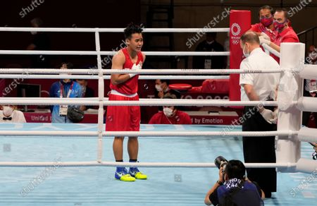 Philippines' Nesthy Petecio bows towards the referee after winning her women's featherweight 57-kg semifinal boxing match against Italy's Irma Testa at the 2020 Summer Olympics, in Tokyo, Japan