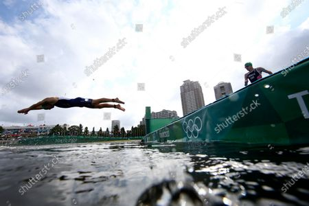 Kevin Mcdowell, of the United States, left, and Jonathan Brownlee, of Britain, compete in the mixed relay triathlon at the 2020 Summer Olympics, in Tokyo, Japan