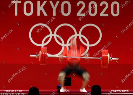 Stock Photo of A slow shutter speed image shows Nico Mueller of Germany competing in the men's 81kg category group A during the Weightlifting events of the Tokyo 2020 Olympic Games at the Tokyo International Forum in Tokyo, Japan, 31 July 2021.