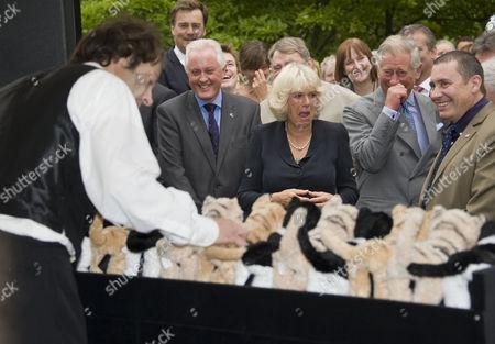 Camilla Duchess of Cornwall, Prince Charles and Jools Holland watching Henry Dagg playing his organ of cats