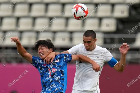 New Zealand's Winston Reid, right, and Japan's Daichi Hayashi battle for the ball during a men's quarterfinal soccer match at the 2020 Summer Olympics, in Kashima, Japan