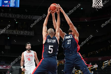 Stock Picture of Rudy Gobert and Nicolas Batum of Team France fight for the ball during the men's preliminary round group A basketball match between Islamic Rep. of Iran and France during the Tokyo 2020 Olympic Games at the Saitama Super Arena in Saitama on July 31, 2021.