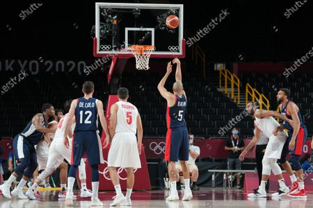 Stock Image of Nicolas Batum of Team France takes a shoot during the men's preliminary round group A basketball match between Islamic Rep. of Iran and France during the Tokyo 2020 Olympic Games at the Saitama Super Arena in Saitama on July 31, 2021.