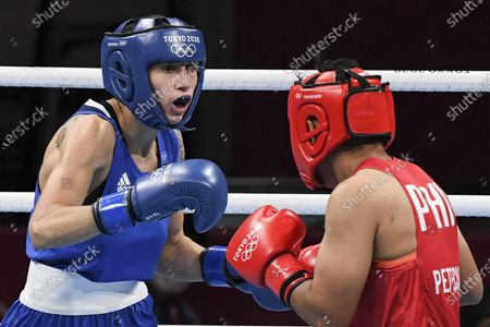 Stock Picture of Irma Testa of Italy (in blu) in action against Nesthy Petecio of the Philippines during their bout in the Boxing Women's Feather (54-57kg) Semifinal of the Tokyo 2020 Olympic Games at Kokugikan Arena in Tokyo, Japan, 31 July 2021.