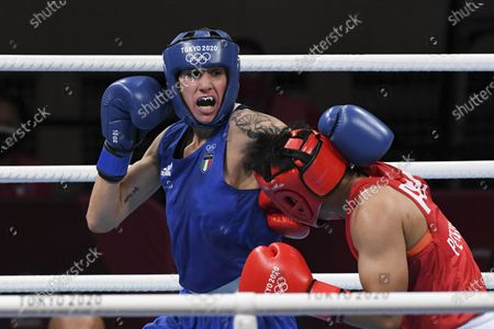 Stock Photo of Irma Testa of Italy (in blu) in action against Nesthy Petecio of the Philippines during their bout in the Boxing Women's Feather (54-57kg) Semifinal of the Tokyo 2020 Olympic Games at Kokugikan Arena in Tokyo, Japan, 31 July 2021.