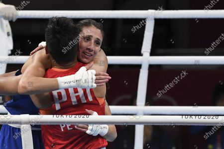 Stock Image of Irma Testa of Italy (in blu) embraces winner Nesthy Petecio of the Philippines at the end of their Boxing Women's Feather (54-57kg) Semifinal of the Tokyo 2020 Olympic Games at Kokugikan Arena in Tokyo, Japan, 31 July 2021.