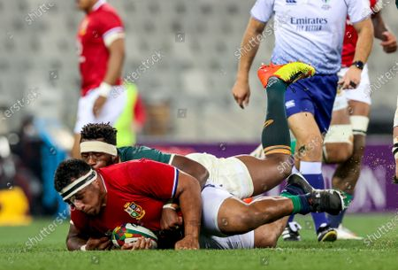 Stock Photo of Castle Lager Lions Series Second Test, Cape Town Stadium, Cape Town, South Africa 31/7/2021. South Africa vs British & Irish Lions. British & Irish Lions' Mako Vunipola is tackled by Siya Kolisi of South Africa