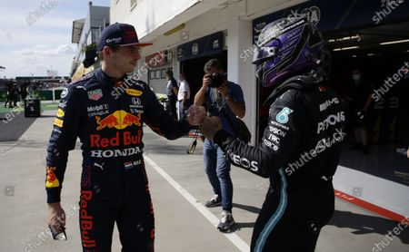 British Formula One driver Lewis Hamilton (R) of Mercedes-AMG Petronas greets third placed Dutch driver Max Verstappen (L) of Red Bull Racing at parc ferme after taking the pole position in the qualifying session of Formula One Grand Prix of Hungary at the Hungaroring circuit in Mogyorod, near Budapest, Hungary, 31 July 2021. The Formula One Grand Prix of Hungary will take place on 01 August 2021.