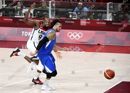 United States' Khris Middleton and Czechoslovakia's Blake Schilb race for a loose ball during a Men's Basketball game at the Tokyo 2020 Olympics, Saturday, July 31, 2021, in Tokyo, Japan. USA won, 119-84.         PhoKhris to by Mike Theiler/UPI