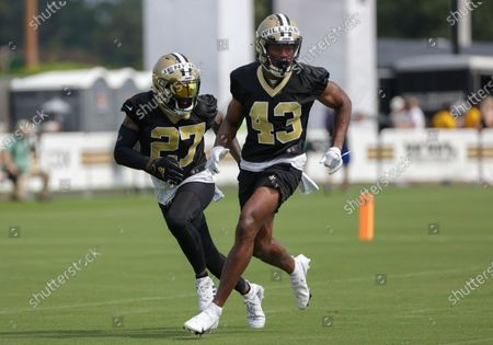 Stock Image of New Orleans Saints strong safety Malcolm Jenkins (27) and free safety Marcus Williams (43) run a drill during NFL football training camp in Metairie, La