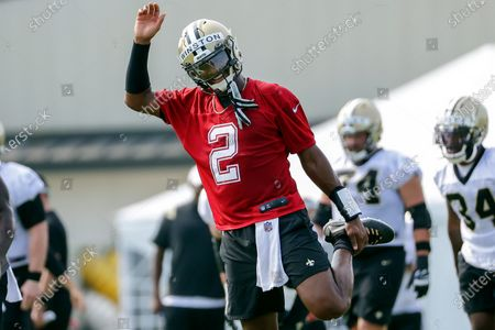 New Orleans Saints quarterback Jameis Winston (2) stretches during NFL football training camp in Metairie